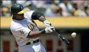 Oakland's Frank Thomas connects for a two-run home run in the first inning. The Athletics defeated Kansas City, 7-0, Wednesday in Oakland, Calif.