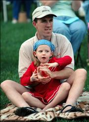 Kevin Babbit with his daughter Katie, 5, watching the Lawrence City Band.