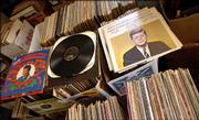 An Elvis Christmas Album and selected speeches of John F. Kennedy rest among the piles of albums up for auction.