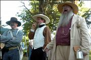 Edward Hoover, far right, playing the part of Douglas County Sheriff Samuel Jones, shouts at the beginning of the program Friday at the sesquicentennial commemoration of the Battle of Black Jack at the site near Baldwin. Hoover is joined by John Nichols, far left, and Tim Rues, both dressed for the occasion.