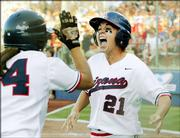 Arizona's Kelly Nelson (21) celebrates with Chelsie Mesa after Nelson scored during the sixth inning of an NCAA softball tournament game against Texas in Oklahoma City, Friday, June 2, 2006. Arizona won 2-0.