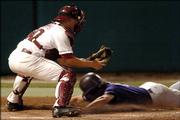 Texas Christian center fielder Ryan Pack scores as Oklahoma catcher Jackson Williams (20) gets set to tag him too late, Friday, June 2, 2006, during an NCAA regional game in Norman, Okla. TCU defeated Oklahoma 6-5.