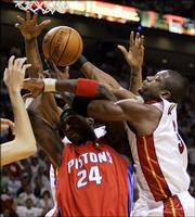Miami Heat's Dwyane Wade, right, gets tangled up with Detroit Piston's Antonio McDyess (24) during the first quarter of Game 6 of the NBA basketball Eastern Conference finals in Miami on Friday, June 2, 2006.
