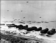 This is the scene along a section of Omaha Beach in June 1944, during Operation Overlord, the code name for the Allied invasion at the Normandy coast in France during World War II.