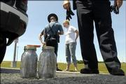 Kansas Highway Patrol troopers searched a car and found two jars of suspected marijuana and drug paraphernalia in a car heading toward the 2006 Wakarusa Festival in this file photo. Two minor drug cases, including one in Lawrence, have led to major constitutional questions before the Kansas Supreme Court over when police can search a person.