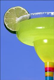 A margarita by the poolside offers a taste of paradise. Webtender.com recommends mixing 1 1/2 ounces tequila, 1/2 ounce triple sec and rubbing 1 ounce of lime juice around the glass rim.