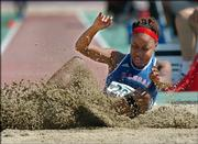 Kansas University's Charisse Bacchus lands in the pit after an attempt in the long jump preliminaries at the NCAA track and field championships. Bacchus was second overall Wednesday in Sacramento, Calif., and qualified for today's finals.