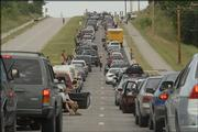 If you were headed west on Clinton Parkway this morning, this is the sight you found - hundreds of vehicles backed up as tourists were heading into the Wakarusa Music and Camping Festival at Clinton Lake.  This shot was taken about 8:30 a.m. as traffic was backed up heading west about 1.5 miles east of the lake on Clinton Parkway.
