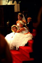 Bride to be Betsey Johnson sits near the altar of the First United Methodist Church with her flower girls and ring bearer before her wedding ceremony, April 29. They are Bridgette Johnson, Hunter Johnson and Ethan Johnson.