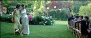 Niki Schneider, left, mother of the bride and Margot Keizer walks  across the lawn of Williams House  towards the waiting bridal party and the groom, Michael Zigmont. Mrs. Schneider presented the bride to the groom in the wedding ceremony, May 13.