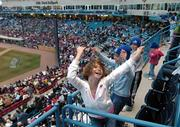 From left, Taryn Sack, 10, Danielle Gortseman, 9, and Justin Gortsema, 7, dance and cheer on the West Michigan Whitecaps, a minor-league baseball team located in Grand Rapids, Mich.