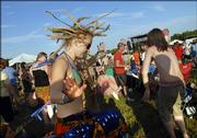 Jenny Aberle, Fargo, N.D., lets her dreadlocks fly as she and thousands of Wakarusa Festival partiers dance to Spearhead on Friday evening at Clinton State Park.