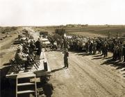In 1955, Kansas Gov. Fred Hall spoke from a flat-bed trailer near Big Springs, 12 miles west of Lawrence, commemorating the pouring of the first concrete and the beginning of the paving for the Kansas Turnpike. The 236-mile turnpike was constructed in 22 months and opened Oct. 25, 1956.