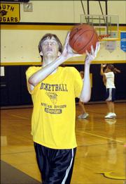 Mark Laskowski goes in for a lay-up at the LHS Shooting Camp on Wednesday.  The camp is designed to help players like Laskowski improve their shooting form.