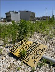 The former Farmland Industries fertilizer plant east of Lawrence is now a desolate, rusted wasteland. A private company specializing in environmental remediation wants to purchase the land and clean it up, paving the way for redevelopment.