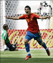 Spain's David Villa celebrates after scoring Spain's second goal. Villa scored twice in Spain's 4-0 victory over Ukraine on Wednesday in Leipzig, Germany.