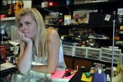Carrie Neighbors waits for customers inside her secondhand store, The Yellow House, 1904 Mass. The Federal Bureau of Investigation is looking into the Lawrence Police Department because of allegations that officers were posing as federal agents in a fencing probe involving Yellow House.