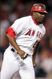 The Los Angeles Angels' Vladimir Guerrero trots around the bases after hitting a two-run home run against the Kansas City Royals. The Angels topped the Royals, 3-2, Thursday in Anaheim, Calif.
