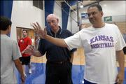 Kansas University assistant basketball coach Kurtis Townsend, right, and his dad, Raymond Sr., interact with campers at Bill Self's basketball camp. One of the elder Townsend's claims to fame is playing junior college basketball in San Jose, Calif., at the age of 39.