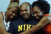 Wayne Ricks, center, gets a lot of attention from his two daughters Cherrale, 20, left, and Kizzie, 25. Cherrale plays basketball for Park University in Parkville, Mo., and Kizzie teaches and coaches at French Middle School in Topeka.