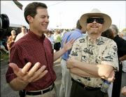 Sen. Sam Brownback, left.
