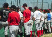Ninth grade participants in Free State High School's summer baseball camp watch as fellow participants hit balls with a coach.  The camp allows incocming ninth graders the chance to improve on their skills before trying out for high school baseball teams.