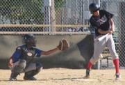 Houk League Storm player Jacob Bread bats for his team in their match-up against the Bulls on Wednesday at Holcom Park.  Storm eventually beat the Bulls 13-11.