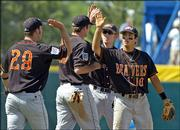 Oregon State players, from left, Shea McFeely, Bill Rowe, Chris Kunda and Darwin Barney, exchange high-fives after beating Georgia, 5-3. The Beavers won Monday in Omaha, Neb.