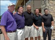 New Kansas State football coach Ron Prince, center, gets his photo taken with KSU Catbackers, from left, Mike Truta, Kansas City, Mo.; Craig Folkers, Leawood; Kevin Kleweno, Overland Park; and Joel Kaczor, Lawrence. The five participated in the Jake Ochs Golf Classic on Monday at Alvamar.