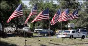 Flags fly in the front yard of missing Army Pfc. Thomas Lowell Tucker's home in Madras, Ore. Tucker is one of two U.S. soldiers missing in Iraq. On Monday, some 8,000 Iraqi and U.S. troops were conducting a massive search south of Baghdad.