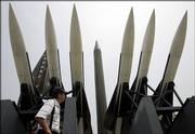 A tourist walks by displays of models of North Korea's Scud-B missile, center, and other missiles at the Korean War Memorial Museum in Seoul, South Korea. Opponents of a possible North Korean long-range missile test on Monday stepped up a diplomatic drive to stop the launch, issuing a barrage of warnings to the reclusive nation and threatening retaliation if it goes ahead.