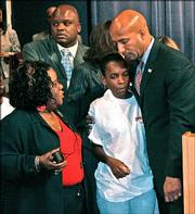New Orleans Mayor Ray Nagin hugs Monalisa Hunter at the conclusion of a news conference at the City Council Chambers in New Orleans. Nagin asked the governor Monday to send National Guard troops to patrol his city after a violent weekend in which five teenagers were shot to death and a man was fatally stabbed in an argument over beer. Hunter lost two sons Arsenio Hunter, 16, and Marquis Hunter, 19, in the shooting. Joining Hunter and Nagin was Barbara Lacen Keller, Arsenio Hunter's godmother.