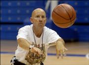 Phil Anderson, a former basketball coach at Hutchinson High, is one of several Kansas coaches working with campers at Bill Self's basketball camp. Here, Anderson passes the ball during a drill Tuesday at Allen Fieldhouse.