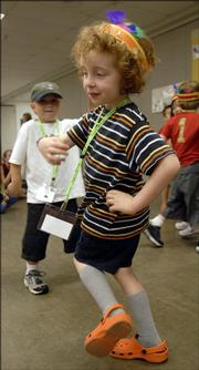 Zachary Hill, 5, Lawrence, dances to some salsa music Tuesday morning during the annual Sertoma-Schiefelbusch Communication Camp at the Douglas County 4-H Fairgrounds. The camp has grown over the years and serves a variety of children.
