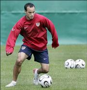 Team USA midfielder Landon Donovan dribbles the ball during a training session. Donovan has shown two sides to his game during the 2006 World Cup - lacking aggressiveness in the opener against the Czech Republic while rebounding to play an intense game Saturday against Italy. The big question for the U.S. is how he performs Thursday in a must-win game against Ghana.