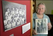 Helen Krische, archivist at Watkins Community Museum, has created a panel of historic photos and papers from her research into Lawrence's Hispanic community. The exhibit will be on display at St. John's Mexican Fiesta. At left is a photo of a children's dance troupe, and at right Krische holds a portrait of Maria and Jesse Ramirez, who settled in Lawrence.