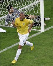 Brazil's Ronaldo celebrates a goal as Japan goaltender Yoshikatsu Kawagushi stays in the net. Brazil won, 4-1, Thursday in Dortmund, Germany.