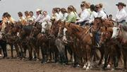 Cowgirls line up for the opening ceremony at the Ranch Rodeo Association's Qualifying Rodeo for the National Finals.  Over forty women competed in the qualifier on Saturday at the Stinson Creek Cattle Co.