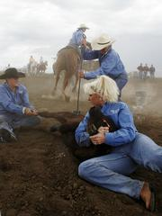 Team Hinchman Ranch completes its calf branding at the Women's Ranch Rodeo Assn.'s Qualifying Rodeo. Team Hinchman Ranch, which includes roper Jennie Buchman, on horse, Debbie Hoy, branding, Staci Mitchell, right, and Sheryl Bailey-Cutsinger, left, was one of 11 teams from across Kansas and Oklahoma that competed in the qualifier for the National Finals on Saturday at Stinson Creek Cattle Co. west of Lawrence.