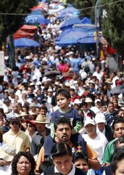 Thousands of people go to the Basilica of Guadalupe on Saturday in Mexico City to pray for peace and unity in Mexico ahead of the presidential elections on July 2.