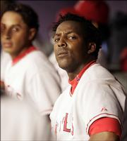 Los Angeles Angels outfielder Vladimir Guerrero sits in the dugout in this file photo from Friday in Phoenix. Guerrero is the only All-Star Game vote-getter not from the Yankees or Red Sox to lead voting at his position.