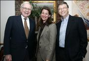 Warren Buffett, left, Melinda Gates and Bill Gates stand together on Sunday in New York, shortly after Buffett's announcement that he would begin making an annual donation to the Bill and Melinda Gates Foundation.