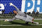 Australia goalkeeper Mark Schwarzer fails to make a save on a penalty kick by Italy's Francesco Totti during the quarterfinals of the World Cup. Totti's goal was the game-winner in Italy's 1-0 victory Monday at Kaiserslautern, Germany.