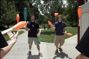 Bradley Barger, left, and Tio Duermeier use some of their juggling equipment while practicing in South Park. During a recent trip to Nebraska, about $1,000 worth of equipment was taken from members of the Kansas University Juggling Club.