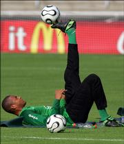 Team Brazil goalkeeper Dida controls a ball on his foot during a training session. Brazil practiced Wednesday at Bergisch Gladbach on the outskirts of Cologne, Germany, in preparation for Saturday's World Cup quarterfinal game against France.