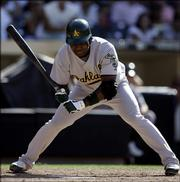 The Oakland Athletics' Antonio Perez takes ball four to force in the go-ahead run in the 14th inning. The walk came after the San Diego Padres intentionally walked Eric Chavez. That run won the game for Oakland, 6-5.