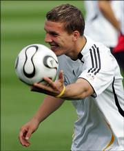 Lukas Podolski, of the German national soccer team , holds a ball during a training session near the FIFA World Cup stadium in Berlin, Germany, Thursday, June 29, 2006. Germany prepares for the soccer World Cup quarterfinal against Argentina on Friday, June 30, 2006.