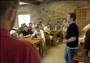 Pi Kappa Phi fraternity vice president Tanner Burns speaks to a group of prospective new members in the fraternity's dining room. Incoming freshmen toured the Kansas University fraternities during formal recruitment last weekend before receiving bids and selecting a house Monday afternoon.