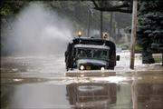 A military truck from the Cedar Bridge Military Academy drives in floodwater Thursday as service members check for stranded residents in Trenton, N.J.