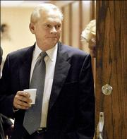 Former Oklahoma district judge Donald Thompson walks into the courtroom Thursday at the courthouse in Bristow, Okla. A jury found Thompson, 59, guilty of four counts of indecent exposure.